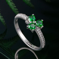 Green crystal shamrock ring symbol